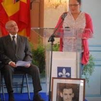 Marie-Charlotte, au pupitre, derrière le portrait de Jacques Bouldoire, pendant son allocution. (D.R. Stéphane Amélineau)